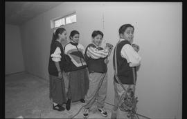 Coast Salish youths using power tools during gym construction [4 of 8 photographs]
