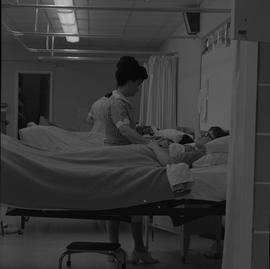 Practical nursing, Nanaimo, 1968; nurses attending to a patients