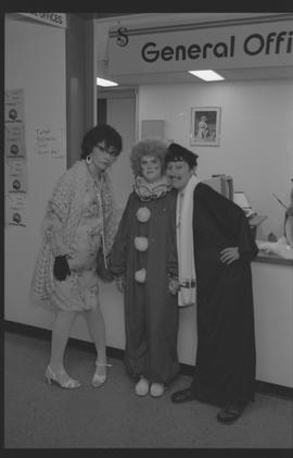 General Office staff dressed as a housewife (?), clown, and priest [2 of 11 photographs]
