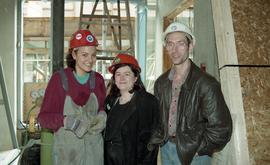BCIT women in trades; student and three BCIT employees (?) wearing hard hats while standing at a ...