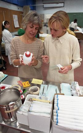 General Nursing, students and nurse with supplies [5 of 7 photographs]