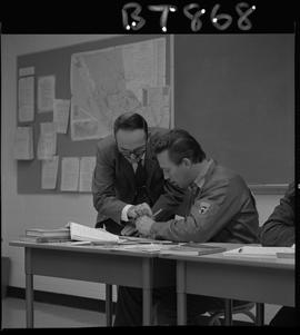 BC Vocational School image of a BTSD Basic Training program instructor teaching a student in a cl...