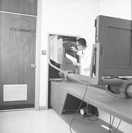 BCVS Graphic arts ; a man adjusting settings for a dark room camera [2 of 2]