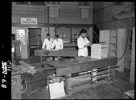 B.C. Vocational School image of the inside of the Carpentry shop including workbenches with a stu...