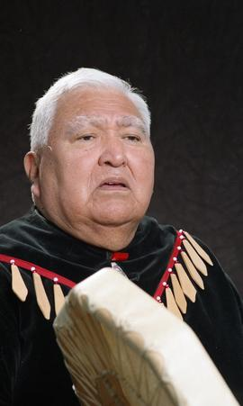 Bob George, First Nations elder, in First Nations garment playing an instrument [2 of 36 photogra...