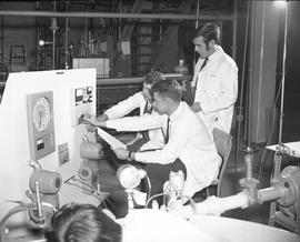 BCIT Programs Gas & Oil Technology ; two men adjusting dials on equipment ; one man observing