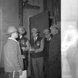 Forestry, Wood fiber BCIT tour, November 26, 1965; a group of men wearing hard hats in a factory