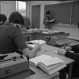 BC Vocational School Commercial Program; students using shorthand to record information in steno ...