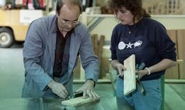 BCIT Women in Trades; carpentry, two people marking and measuring a piece of wood [1 of 6 photogr...