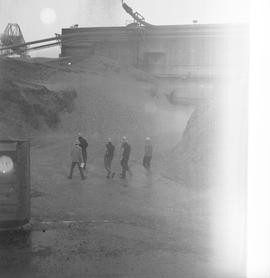 Forestry, Wood fiber BCIT tour, November 26, 1965; men walking outside of wood fiber factory