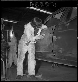 BC Vocational School image of Autobody program students working on a vehicle in the shop [6 of 8 ...