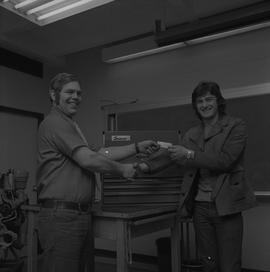 Tool box presentation; two men shaking hands