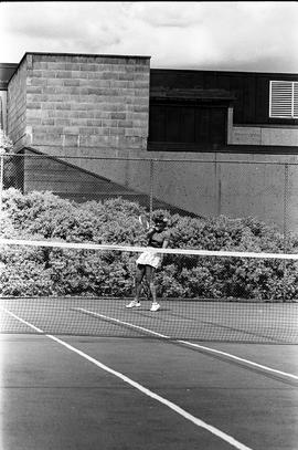 BCIT image of a women playing tennis on a BCIT Tennis Court.