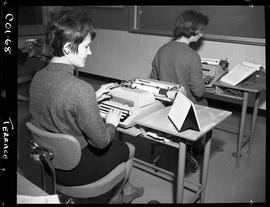 B.C. Vocational School; two Commercial Program students typing in a classroom