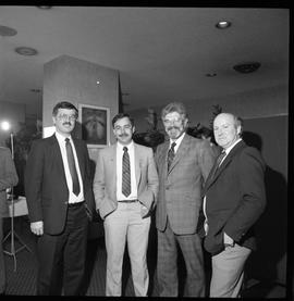 Merger of BCIT and PVI celebrations April 1986; four men posed together