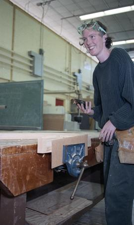 BCIT Women in Trades; carpentry, women using vice [2 of 3 photographs]