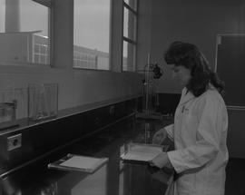 Food Processing Technology, 1966; woman wearing a lab coat performing a food processing test [1 o...