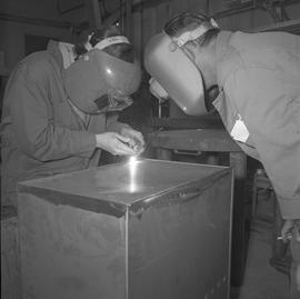 Sheet metal, 1968; instructor watching a student welding a metal box [1 of 2]