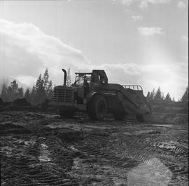 Heavy duty equipment operator, Nanaimo ; man operating an Allis-Chalmers 260 scraper