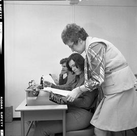 BC Vocational School Commercial Program; instructor talking to a student in a typing class [2 of 2]