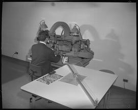 Survey, 1968; man using a stereo plotter