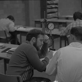 Stationary engineering upgrade, Victoria, 1968; students working in a classroom [1 of 3]