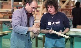 BCIT Women in Trades; carpentry, two people marking and measuring a piece of wood [3 of 6 photogr...