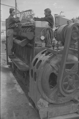 Pacific Vocational Institution ; two men working on large machinery [2 of 4]