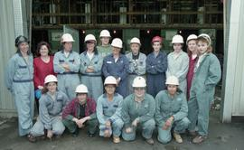 Trades discovery for women; piping, group shot of instructors (?) and students in uniform and hel...