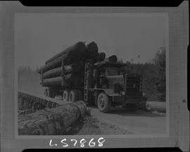 Logging, 1968; copy negative; picture of a truck with carrying logs