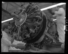 British Columbia Vocational School image of Aeronautics students working on an aircraft engine in...