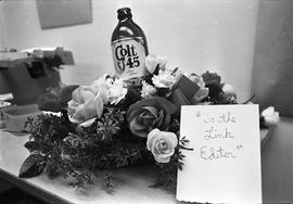 "Colt 45 bottle of beer with a bouquet of flowers: ""To the Link Editor"""