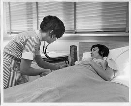 BCVS Nursing student with stethoscope and patient in bed [2 of 2 photographs]
