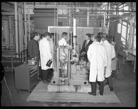 Mechanical technology, 1967; a group of men in lab coats standing in front of a chalkboard and ne...
