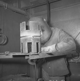 Welding, Terrace, 1968; person wearing a face shield welding [3 of 3]