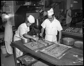 BC Vocational School Cook Training Course ; two students glazing pastry desserts ; students worki...