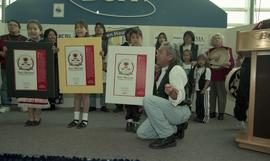 "BCIT open house '98, First Nations youths and elder on stage holding posters that read ""Firs..."