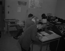 BCIT Broadcast and Television, 1966; three people working on paperwork in a radio control room [2...