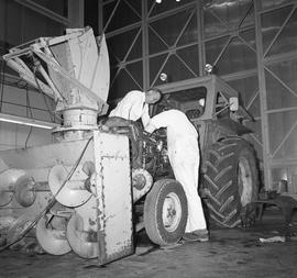 BCVS Heavy duty mechanic program ; front view of a tractor ; a student working on the tractor eng...