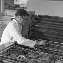 BCVS Graphic arts ; man adjusting settings on a printing press [2 of 2]