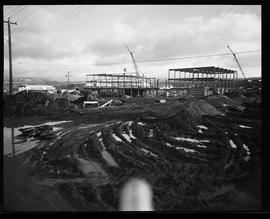 Construction of BCIT in progress, muddy field and framed buildings