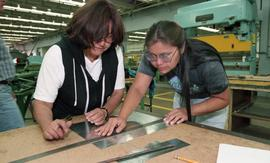 Pre-trade Aboriginal women; sheet metal, students using materials and equipment in class [10 of 1...