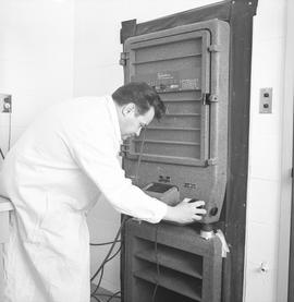 BCVS Graphic arts ; man using a Robertson 320 dark room camera