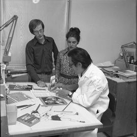 BCVS Graphic arts ; three people at a desk discussing graphic designs [3 of 3]
