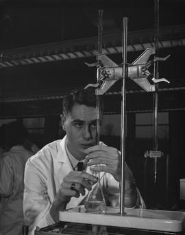 Medical Lab; man in a lab coat using a medical lab device
