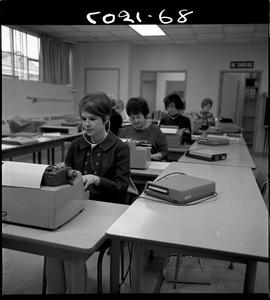 B.C. Vocational School; Commercial Program students in a classroom using a typewriter to transcri...