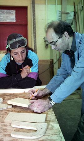BCIT Women in Trades; carpentry, looking at and making marks on wood [2 of 3 photographs]