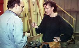 BCIT Women in Trades; carpentry, woman and man talking in workshop [1 of 2 photographs]