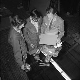 BCVS Glazier program ; three men standing next to a large piece of glass