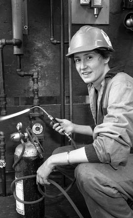 BCIT Women in Trades; plumbing, Megan with welding torch, February 1994 [1 of 5 photographs]